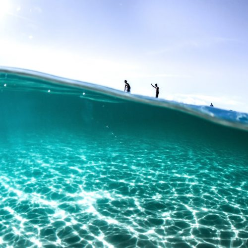 looking-underwater-to-surfers-on-wave